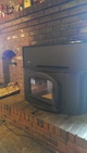 Wood stove installed in a fireplace