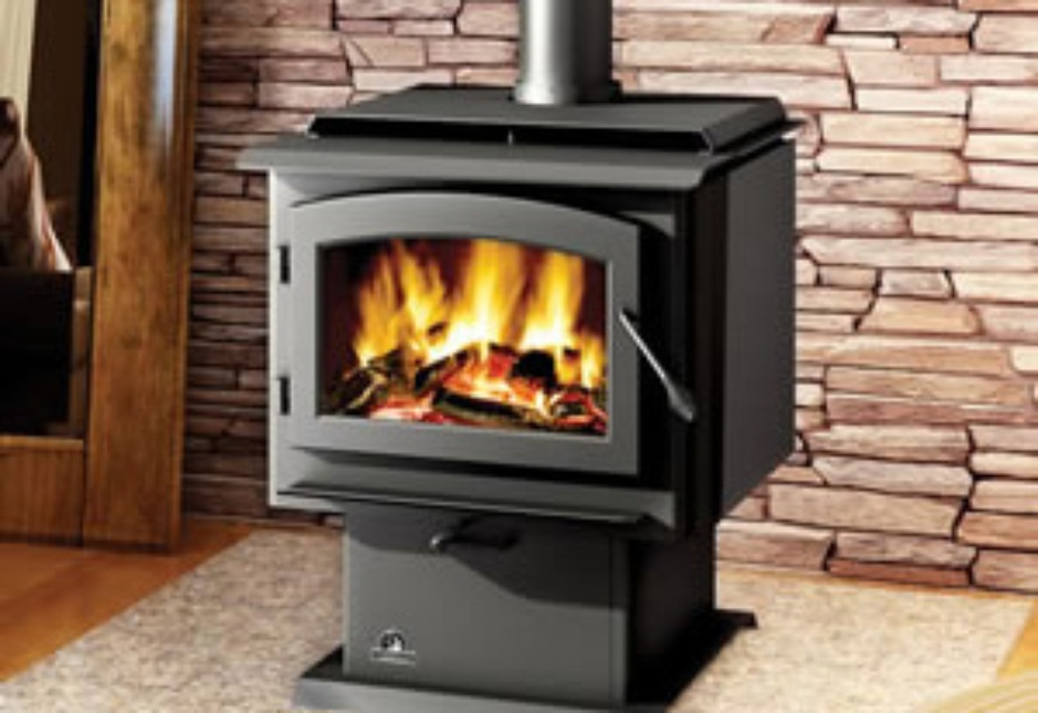 Wood stove in a fireplace