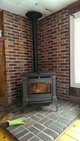 Pellet stove in front of a brick wall