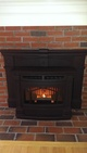 Pellet stove installed in a fireplace