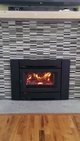 Wood-Burning Fireplace On Bricked Slab