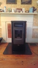 Pellet stove in a fireplace